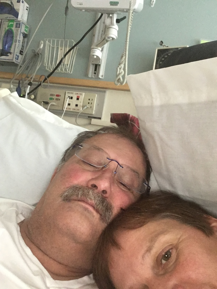 Denise and Mike in bed at the hospital